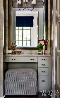 A metallic patterned wallpaper by Cole & Son through Lee Jofa adds a dose of chic to the powder room.
