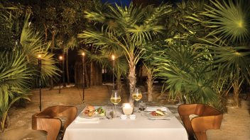 Dinners are set up in various romantic settings, mostly on the beach under the palm trees.