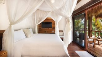 The Lak'in ocean bungalow, with its canopied king-size bed and front porch, looks out to the sea through a breathtaking landscape which is continuously and meticulously maintained.