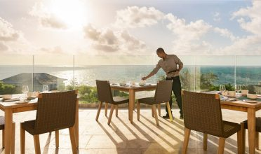 The Atlantic Ocean and Caicos Bank serve as the backdrop at Sailrock's Great House Restaurant.
