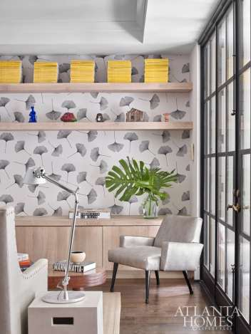 Gingko-patterned wallpaper by Marimekko is a nod to the family's beloved gingko tree, which adds a golden accent to the front of the house each autumn.