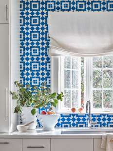 The kitchen's blue-and-white cement tile backsplash captures the family's youthful spirit.