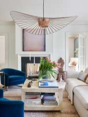 Interior designer Meredith McBrearty's home office reflects her penchant for taking design risks, as antique, vintage and more modern elements act in harmony. She designed the coffee table in collaboration with Mitchell Yanosky Furniture and named it after her son, Stuart. The chandelier is from the MoMA Design Store.