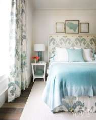 A guest bedroom's calming color scheme is punctuated with playful pattern on the draperies, headboard and dust skirt.