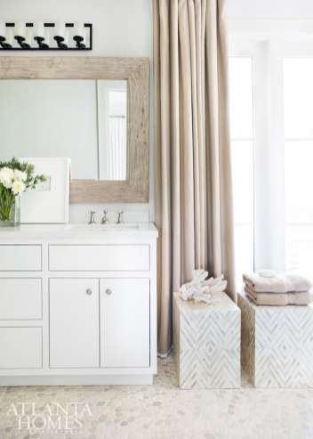 Driftwood-inspired tones in a guest bath are a subtle nod to this home's coastal setting.