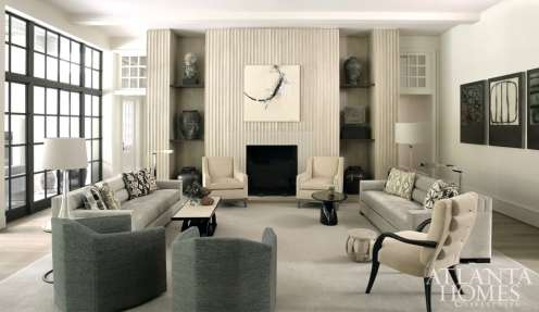 The family room features a spectacular showpiece: a scalloped fireplace wall crafted from limestone and white oak panels that perfectly align.