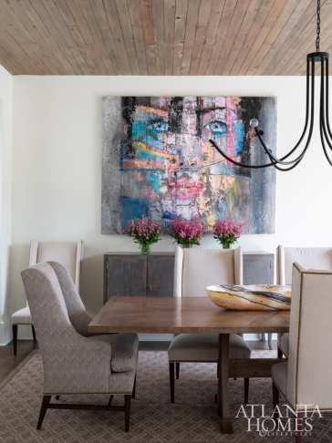 The dining room is anchored by a large-scale mixed-media piece by Fabio Modica, represented through Bill Lowe Gallery.