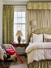 The homeowners' existing bedroom suite, including the draperies, moved with them to their new five-bedroom Atlanta home. The fabric is Zoffany and bedding is by Rose Tarlow.