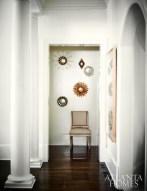 The master bedroom vestibule displays a collection of starburst mirrors.