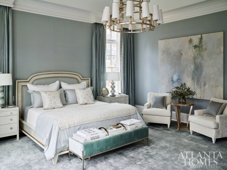 "Upholstered walls in linen by Rogers & Goffigon gives the master bedroom a feeling of warmth and quietness enhanced by the wool-and-silk rug, draperies and plush bedding. ""It's dressed up, but it has a casual elegance,"" Kasler says."