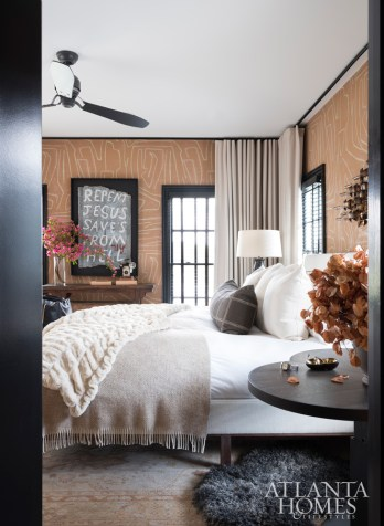 Kelly Wearstler's Graffito wallpaper lends the master bedroom a graphic element. Wool draperies by Holland & Sherry add softness.