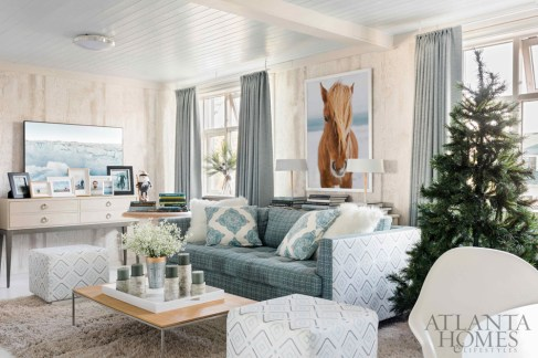 In classic Nordic style, Flynn's contractor covered the living room walls in Thibaut's Eastwood faux bois in a frosty gray tone. The Icelandic horse photo is by Rustic White Photography.