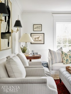 """""""I wanted our home to be a bright, beautiful backdrop for the memories we were about to create as a family,"""" says Lauren Lowe of her vision. The chairs are Bungalow Classic for Highland House; the Bennison and Jasper pillow fabrics are from Ainsworth-Noah."""
