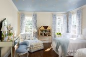 In the grandchildren's room, a blue-and-white Summerhill fabric sets a serene tone. Jones reupholstered dollhouse furniture to fit its new setting. A mirrored dressing table will grow with her granddaughter.
