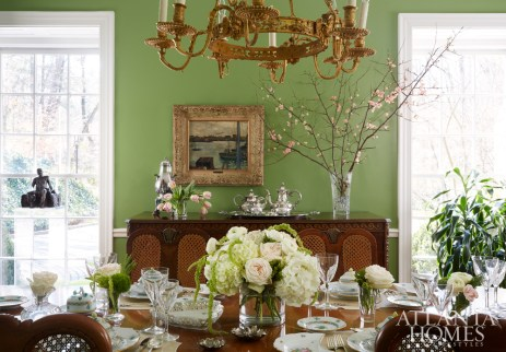 Handmade silver pieces from Germany rival a French painting and a sculpture by B.J. Coughlin. The English table from Turnage Place Estate Sales Co. is set with Baccarat crystal, Wallace Grand Baroque silver, Herend china and Sferra linens.