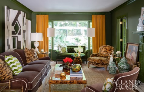 One of interior designer Melanie Turner's favorite items in the house, a green velvet settee by Bernhardt Design, is part of an eclectic mix of furnishings that includes a comfortable chair covered in leopard fabric from Schumacher and a sofa from Lee Industries.