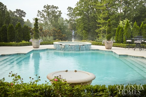 The boxwood hedge around the pool, which the client requested, enhances the pool complex and the garden.