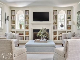For a more relaxed setting, Howard selected seating in plush fabrics to maximum the coziness factor. The slipper chairs and ottoman are Mrs. and Mrs. Howard for Sherrill Furniture and the sconce is Visual Comfort.