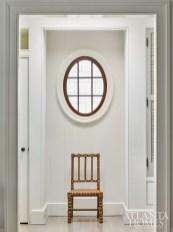 An antique chair graces a hallway.