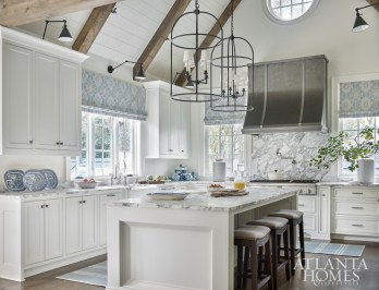 The pewter-clad vent hood from Francois & Co. provided the jumping-off point for the kitchen.