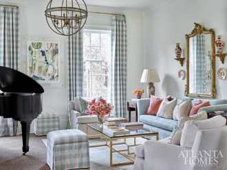 """""""While Jane has a vast collection of blue-and-white porcelain, she also had plenty of Imari, so we pulled the salmon hue from that porcelain to mix in with the blue and white color scheme,"""" says interior designer Lauren DeLoach. """"Jane and I both love checks, so they are sprinkled throughout the rooms."""""""