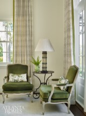 A pair of bergère chairs from Acquisitions in a Cowtan & Tout fabric make a pretty spot for guests to relax and take in the views. The lamp is from The Stalls with an Edgar-Reeves shade.