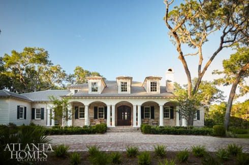 Lowcountry and Creole influences are evident in this lake home's brick and whitewashed cypress siding, says architect Thad Truitt. Homeowner Elizabeth Brunson wanted to combine her native Atlanta's traditional style with the laid-back vibe of Lake Rabun's lakeside living.