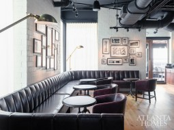 A racetrack-style bar at Ecco Buckhead accommodates after-work crowds.