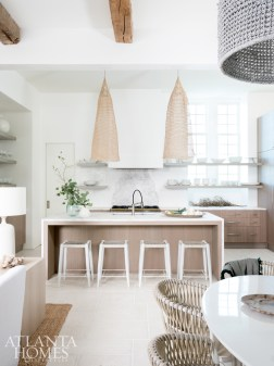 Turner and her team partnered with Atlanta-based company Source on the kitchen's Tasman white marble countertops and washed oak cabinetry. Open shelving adds livable ease.