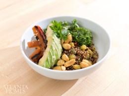 The quinoa bowl comes with kale, avocado, roasted carrot and a peanut vinaigrette.