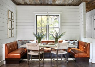 The dining nook features a concrete-top table by Bradley and Bernhardt chairs.
