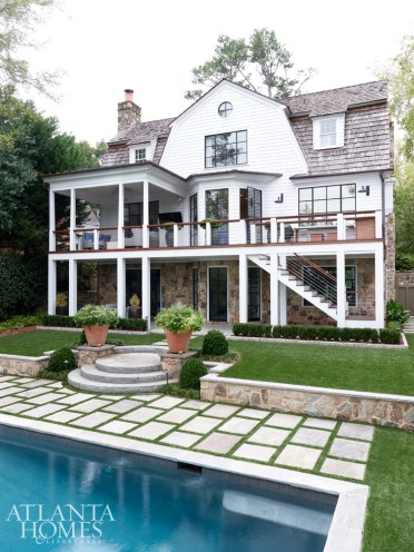 Landscape architect Alec Michaelides led the backyard's redesign, which included removing overgrown landscaping to allow for better views of the pool from the terrace level. Astroturf, both cost effective and environmentally friendly, was utilized throughout the yard.