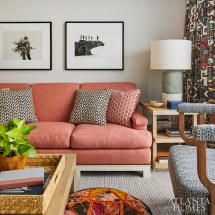 In the den, Howard plays up the homeowner's Western roots with tapestry-like draperies featuring Pierre Frey's Arapahos pattern. The sofa is upholstered in a durable Perennials fabric.