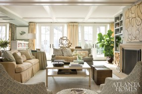 """Antiques were used to elevate the space and we married them with a more contemporary style through art and accessories,"" says Cathy Austin of the living room. Textiles from Cowtan & Tout, Clarence House and Lee Jofa create a sophisticated layer while an ottoman from Highland House and watercolor groupings by Ruth Ava Lyons add youthful flair. The large collage is by Selena Beaudry through Hidell Brooks Gallery."