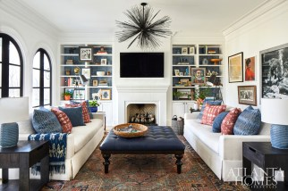 A Kelly Wearstler chandelier for Visual Comfort contrasts with the more traditional furnishings in the family room. The sofas are from Z Gallerie.