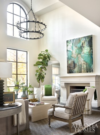An abstract painting by Luis Garcia-Nerey through Holly Hunt Art via the Jim Thompson showroom anchors one side of the formal living