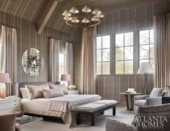 To create a sense of intimacy in the lofty master bedroom, Brown used a wood-veneer wallcovering. A Sandra Jordan alpaca wool was used on the bed's throw and accent pillows.