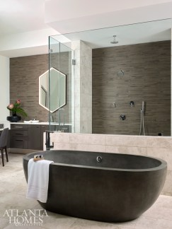 Witzel specified a cast stone and resin tub in the master bathroom; custom Studio Endo mirrors featuring built-in LED lighting were used in lieu of sconces.