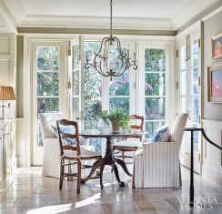 Natural light floods into a cozy breakfast nook.
