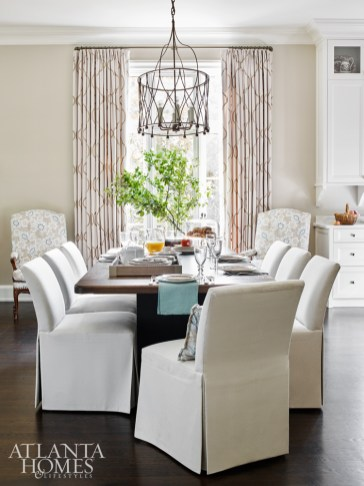 A chandelier by Avrett through R. Hughes showroom illuminates a custom table with a metal base by Smithworks Iron & Design and walnut top by Skylar Morgan in the breakfast area.