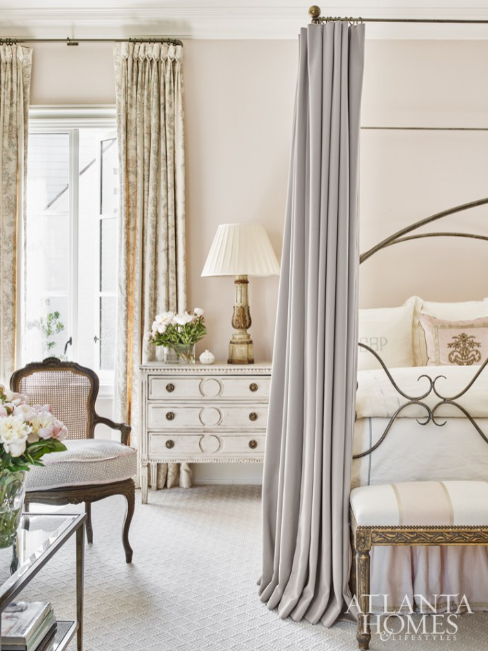 A wall-to-wall carpet from Stark, light pink walls and a balanced mix of antiques and new furnishings foster a sense of serenity.