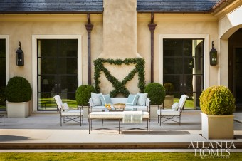 Designed so that the party can spill outside, the back patio features streamlined furnishings from Kolo Collection.