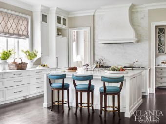 White cabinetry is accented by a linen fabric with a velvet overlay from Mark Alexander. The kitchen was designed in partnership with Cynthia Ziegler.