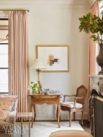 Displayed above an antique desk, artwork by Rocio Rodriguez through Sandler Hudson Gallery is one of the many contemporary art pieces throughout the home.