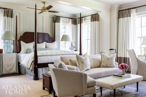 A custom, handcrafted mahogany bed by Reid Classics in Dothan, Alabama, serves as the centerpiece of the generously sized master suite. The private sitting area features a dressing table and prime views of the lake.
