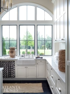 """Tumbled slate tile in a dark hue conveniently hides debris in the laundry room. """"I wanted it to be mutable so when muddy boots walk through, you wouldn't immediately know about it,"""" says Johnson."""