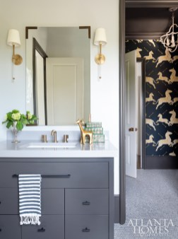 A joint bath and powder room provides easy access to both the youngest son's bedroom and the play space. The zebra wallpaper is by Scalamandré.