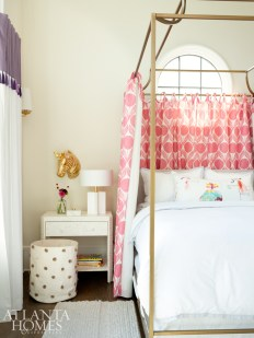 In each daughter's room, canopy beds with panels by Romo are a little girl's dream. The drapes are Schumacher linen with Osborne & Little purple ombre tassel fringe.