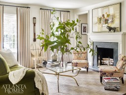 Decorator Betty Burgess complemented the home's leafy surroundings with Clarence House's pink floral linen gracing a pair of slipper chairs and a green velvet covering the sofa.