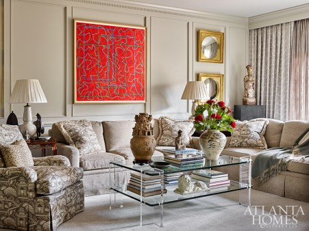 The family room, one of the home's more contemporary-minded spaces, features an abstract painting by Atlanta artist Sidney Guberman and an acrylic coffee table set with a Han dynasty glazed funerary urn and an early Ming dynasty blue-and-white jar.